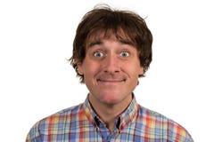 Close-upportret van de verwarde jonge mens in geruit overhemd Stock Fotografie