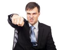 Close-upportret van een boze zakenman die met zijn FI dreigen royalty-vrije stock afbeeldingen