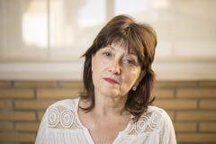 Close-upportret van een rijpe vrouw royalty-vrije stock fotografie