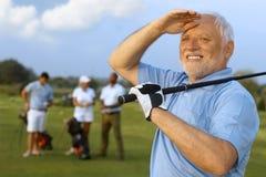 Close-upportret van rijpe mannelijke golfspeler Royalty-vrije Stock Foto's