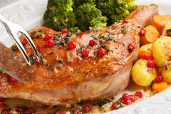 Close uproasted turkey leg being sliced- christmas dish Stock Photography