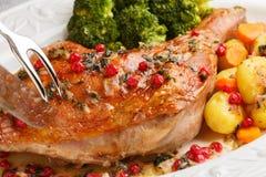 Close uproasted turkey leg being sliced- christmas dish Stock Photography