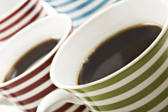 Close ups of mugs of black coffee Stock Photography