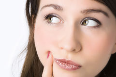 Close-ups portrait. Of the beautiful girl put the face on a hand and holding a finger on a cheek over white background stock images