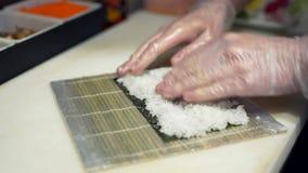 Close-ups are preparing rolls, a Japanese restaurant stock video