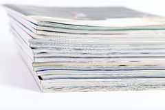 Close-ups of stack of colorful magazines. Publications Royalty Free Stock Image