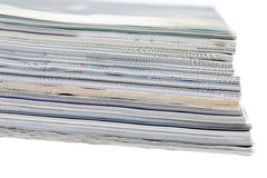 Close-ups of stack of colorful magazines Stock Photo