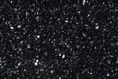 Close-upsamenvatting gebroken gebarsten glas Gebroken glasachtergrond shards Kijkt als steenkool stock foto