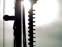 Close-upsilhouet van machine van de Graafwerktuig de hydraulische boring bij een bouwwerf stock foto's