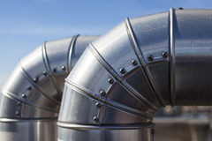 Silver ducts. Close us of two ducts at industrial system ventilation Royalty Free Stock Image