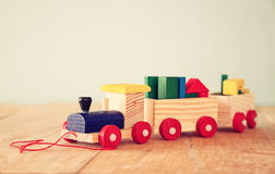 Close ut of Wooden toy train over wooden table. selective focus Stock Image