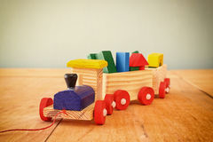 Close ut of Wooden toy train over wooden table. selective focus Stock Photos