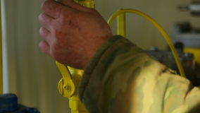 Close the valve. Close up of hands stock video footage
