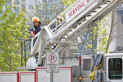 Close on Vancouver Fireman. Close on a fireman as he tests equipment on his fire truck in Vancouver on May 10, 2017 Stock Image