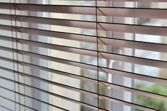 Close on a venetian wooden blinds. In front of a window royalty free stock photography