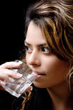 Close view of beautiful woman drinking water Stock Photo
