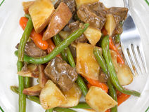 Close view of beef and vegetables with fork Stock Photos