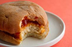 Close view of a bitten chicken sandwich Royalty Free Stock Image