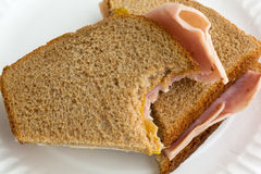 Close view of bitten ham and cheese sandwich Royalty Free Stock Photos