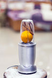 Close view of a blender with an orange and cinnamon sticks on a Royalty Free Stock Photography