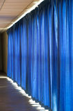 Close view of a blue curtain. Stock Photos