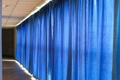 Close view of a blue curtain. Stock Images