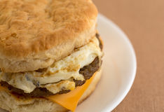 Close view of a breakfast sausage egg and cheese biscuit Royalty Free Stock Photos