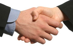Close view of Business handshake male and female. A man's hand in business attire shakes the hand of a woman in business attire isolated on white space Stock Photos