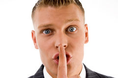 Close view of businessman asking to keep silent Stock Photography