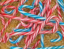 Close view of candy canes in basket Royalty Free Stock Photography