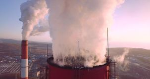 Close view of Central Heating and Power Plant chimney top with steam. Dawning stock footage
