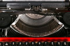 A close view of a certain part of the typewriter. A close view of a certain part of the old red typewriter. Indoors Royalty Free Stock Image