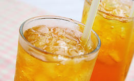 Close view of chilled iced lemon tea. Served in glass with straw Stock Photos