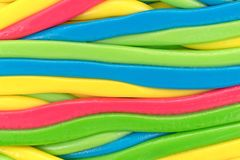 Close view of colorful strings of candy. Very close view of several colorful candy strings Stock Photo