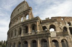 Close view of the Colosseum, Rome. Close view of the Colosseum (coliseum) or Flavian Amphitheater , the first permanent amphitheater to be built in Rome, Italy royalty free stock image