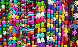 Close view of colourful bead necklaces at market Stock Photos