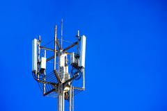 Close view of a Communication tower. High telephone tower. Beautiful sky with a communications tower in the foreground royalty free stock photo