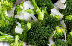 Close view of cooking broccoli and onions Royalty Free Stock Photos