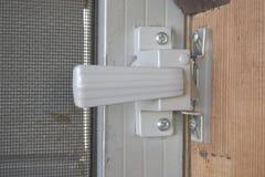 Screen Door Handle. Close view of a crude looking metal screen door handle royalty free stock image