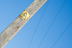 Close view of Danger sign on electricity pole royalty free stock photos