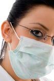 Close view of doctor wearing mask and eyewear Stock Image