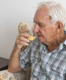 Close View of Elderly Gentleman Eating a Fruit Mince Pie. Royalty Free Stock Photography