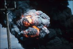 Urban explosion. Close view of an explosion amid the black boiling smoke of an urban disaster Royalty Free Stock Photo