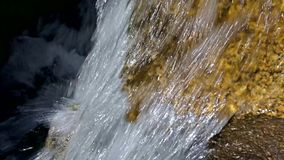 Close view of fast moving water over rocks stock footage