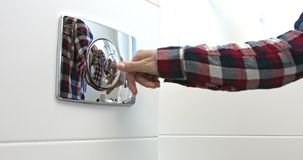 Pressing button for rinse water. Close view of female hand is pressing toilet button for rinse water stock video