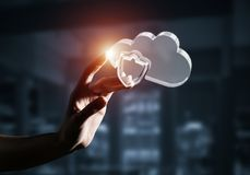 Cloud computing concept with glass symbol shown in hand. Mixed m. Close view of female hand touching with finger cloud icon. Mixed media royalty free stock images