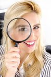 Close view of female looking through lens Stock Photography