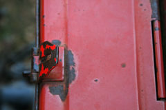 CLOSE VIEW OF FLAP ON SIDEBOX LATCH Stock Image