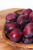 Close view of fresh plums on the wooden board Stock Photography
