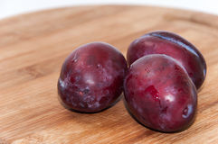 Close view of fresh plums on the wooden board Royalty Free Stock Photography